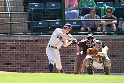 14 April 2013:  Brian Evans bats, A.J. Nathan catches, Steve Jones umpires during an NCAA division 3 College Conference of Illinois and Wisconsin (CCIW) Baseball game between the Elmhurst Bluejays and the Illinois Wesleyan Titans in Jack Horenberger Stadium, Bloomington IL