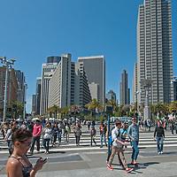 Crowds of Saturday visitors cross The Embarcadero drive near downtown San Francisco, California.