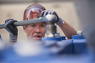 """20170520, Saturday, May 20, 2017, Boston, MA, USA; O.B. Hill's Randy Curtis, of Brockton, unbolts the MRI from it's traveling cradle. Various technical medical installation specialties, lead by the team from O.B. Hill Trucking and Rigging, descended on and into the Brigham Building for Transformative Medicine to deliver only the third """"7T"""" (MAGNETOM Terra) Siemens MRI in the United States into it's predesigned location inside the L2 portion of the advanced research building on 60 Fenwood Road.<br /> Using a crane and plenty of elbow grease and smarts the massive 22 ton unit was lifted through the morning air and lowered through a large access hole into the innards of the building Saturday morning.<br /> <br /> For more information, please contact Haley Bridger, hbridger@bwh.harvard.edu, office: 617-525-6383 cell: 978-807-5302<br /> <br /> ( 2017 © lightchaser photography )"""