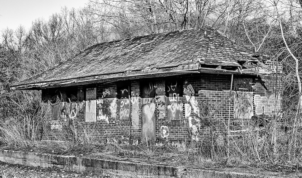 The north bound waiting room at the now abandoned Belle Mead railroad station.  This small building is literally falling apart.  The windows are boarded and the graffiti abounds.