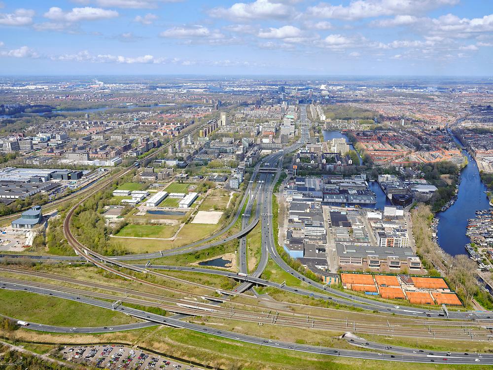 Nederland, Noord-Holland, Amsterdam; 17-04-2021; Zuidas, knooppunt de Nieuwe Meer gezien naar de Coentunnel. Schinkelkwartier / Schinkelhaven.<br /> Zuidas, the Nieuwe Meer junction towards the Coentunnel. Schinkelkwartier / Schinkelhaven.<br /> luchtfoto (toeslag op standaard tarieven);<br /> aerial photo (additional fee required)<br /> copyright © 2021 foto/photo Siebe Swart