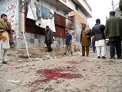 People gather at the blast site in northwest Pakistans Hangu, Feb. 1, 2013. At least 22 were killed and over 40 others injured as suicide bomber targeted outside a mosque in the Pakistan s north-western district of Hangu on Friday afternoon, local media and police said.  February 1, 2013. Photo by Imago / i-Images...UK ONLY