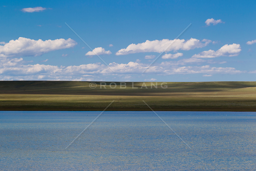 lake and rolling hills in The Land Of Enchantment: New Mexico