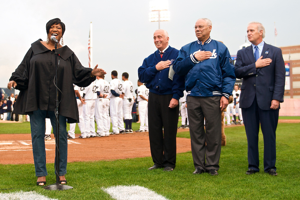 Colin Powell watches as Patti LaBelle performs the the National Anthem at the Newark Bears's Opening Day.