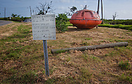 Edison Darder a life long residents' sign on Ise de  Jean Charles next to a survial pod from an oil rig. He wont move off the island though it is no longer safe  during a storm. The threat of flooding is high and inevitable when hurricanes come near the area. The island is eroding steadily and will no longer be habitable in the near future. Ultimately all the inhabitants will become refugees.