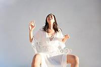 Woman in beautiful white dress laughing.