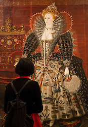 "© Licensed to London News Pictures. 09/10/2013. London, England. A visitor stands in front of a paining of Queen Elizabeth I by an Unknown artist. Press preview of the exhibition ""Elizabeth I & Her People"" at the National Portrait Gallery which explores the remarkable reign of Elizabeth I through the lives and portraiture of her subjects. Exhibition runs from 10 October 2013 to 5 January 2014. Photo credit: Bettina Strenske/LNP"