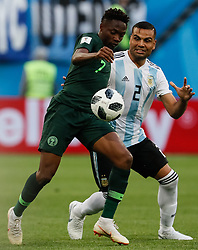 June 26, 2018 - Saint Petersburg, Russia - Ahmed Musa (L) of Nigeria national team and Gabriel Mercado of Argentina national team vie for the ball during the 2018 FIFA World Cup Russia group D match between Nigeria and Argentina on June 26, 2018 at Saint Petersburg Stadium in Saint Petersburg, Russia. (Credit Image: © Mike Kireev/NurPhoto via ZUMA Press)