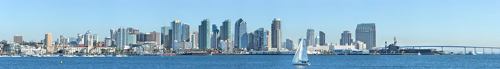Ultra wide view of the downtown San Diego skyline with sailboat in foreground. <br /> <br /> Panorama available up to 30702 x 4242.