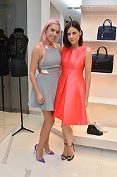 Left to right, AMBER LE BON and LILAH PARSONS at the launch of the new Giusepe Zanotti store in Conduit Street, London on 26th October 2016.