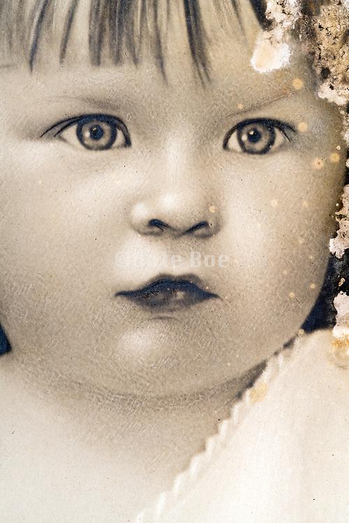 extreme closeup head shot studio portrait of a toddler France ca 1920s