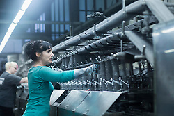 Two women working in the steel wool cleaner industry, Lahr, Baden-Wuerttemberg, Germany