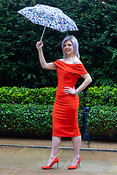 Lucie Hadley, 21, who has been named Slimming World's Young Slimmer of the Year after losing an incredible 10st and halving her bodyweight, poses for photographers at The Ritz in London. London, April 09 2019.