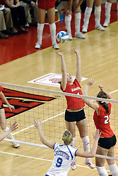 24 November 2006: Erin Lindsey sets the ball for a striker behind her.during a Quarterfinal match between the Illinois State University Redbirds and the Creighton University Bluejays. The Tournament was held at Redbird Arena on the campus of Illinois State University in Normal Illinois.<br />
