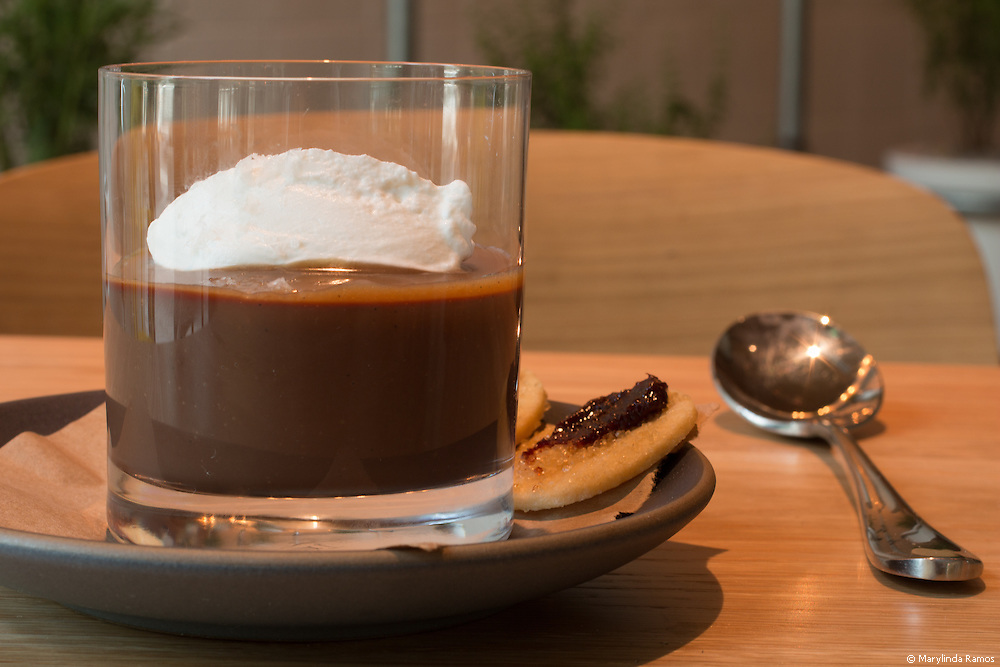 Chocolate pudding is all grown up at Fi'lia.  Dark chocolate custard garnished with caramel sauce, sea salt, and whipped cream with a side of brandied cherry cookies.