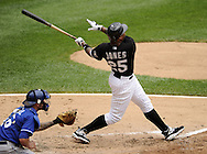 CHICAGO - JULY 11:  Andruw Jones #25 of the Chicago White Sox hits his 400th career home run off of Anthony Lerew #54 of the Kansas City Royals in the third inning on July 11, 2010 at U.S. Cellular Field in Chicago, Illinois.  The White Sox defeated the Royals 15-5.  (Photo by Ron Vesely)