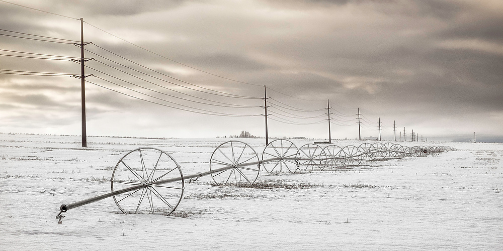 Irrigation wheels adjacent to power lines in Star Valley, Wyoming.