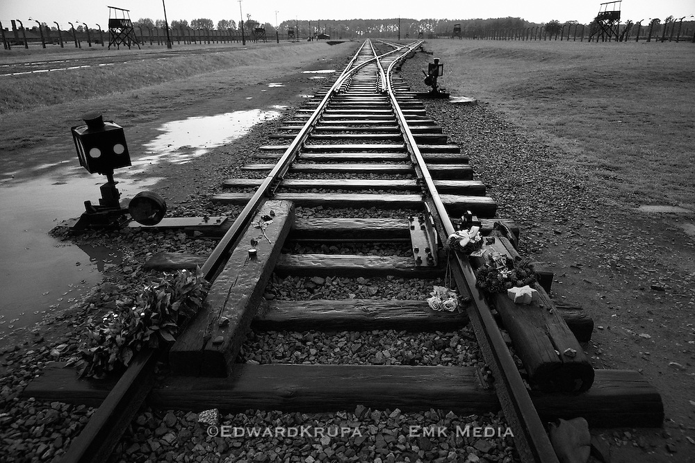 Railroad track inside the Nazi extermination camp Auschwitz 11 Birkenau , Poland. Black and white.