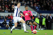 West Brom's Jonny Evans (l) challenges Peterborough's Shaquile Coulthirst.  The Emirates FA Cup, 4th round match, West Bromwich Albion v Peterborough Utd at the Hawthorns stadium in West Bromwich, Midlands on Saturday 30th January 2016. pic by Carl Robertson, Andrew Orchard sports photography.