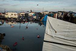 October 26, 2016 - Calais, France - Empty extinguishers are swimming in a big puddle in the Calais Jungle in Calais, France on 26 October 2016. Huge fires destroyed a mayor part of the refugee camp today. (Credit Image: © Markus Heine/NurPhoto via ZUMA Press)