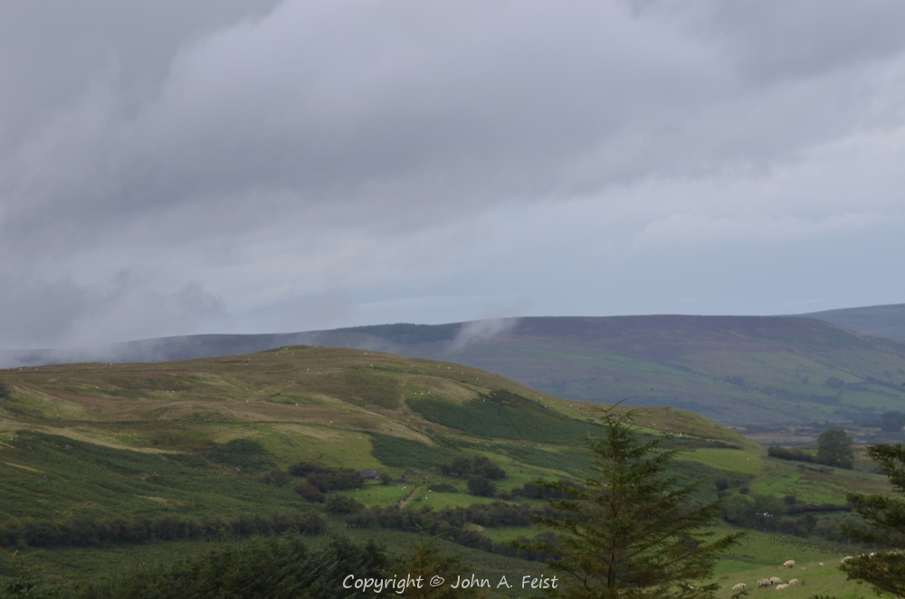 A typical view of the landscape around Cushendall, County Antrim, Northern Ireland.  The weather was very changeable as witnessed by the rising clouds and distant clear sky.