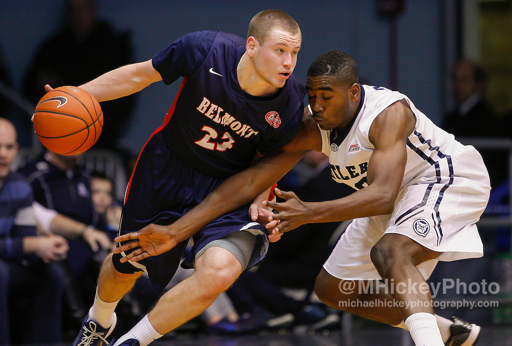 INDIANAPOLIS, IN - DECEMBER 28: Craig Bradshaw #23 of the Belmont Bruins dribbles the ball against Kelan Martin #30 of the Butler Bulldogs at Hinkle Fieldhouse on December 28, 2014 in Indianapolis, Indiana. (Photo by Michael Hickey/Getty Images) *** Local Caption *** Craig Bradshaw; Kelan Martin