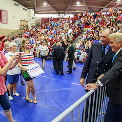 Mechanicsburg, PA – August 1, 2016: John Roberts, Fox News Correspondent, poses with Trump supporters at a political rally.