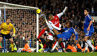 Photo: Ed Godden.<br /> Chelsea v Arsenal. The Barclays Premiership. 10/12/2006.<br /> Chelsea's Didier Drogba (R) attempts a shot on goal.