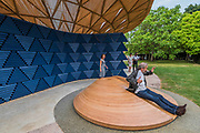 A amn tries out the childrens slide - The new Serpentine Pavillion designed by Francis Kere is opened outside the gallery in Hyde Park.