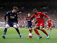 Jack Simpson of Bournemouth holds up Georginio Wijnaldum of Liverpool  during the Premier League match at Anfield, Liverpool. Picture date: 7th March 2020. Picture credit should read: Darren Staples/Sportimage