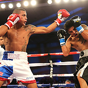 ORLANDO, FL - OCTOBER 04:  Jantony Ortiz (L) catches Gilberto Mendoza with a left during a professional super flyweight boxing match at the Bahía Shriners Auditorium & Events Center on October 4, 2014 in Orlando, Florida. Ortiz would go on to win the fight. (Photo by Alex Menendez/Getty Images) *** Local Caption *** Jantony Ortiz; Gilberto Mendoza