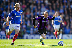 David Clarkson (SCO) of Bristol Rovers is fouled by Jack Whatmough (ENG) of Portsmouth - Photo mandatory by-line: Rogan Thomson/JMP - 07966 386802 - 19/04/2014 - SPORT - FOOTBALL - Fratton Park, Portsmouth - Portsmouth FC v Bristol Rovers - Sky Bet Football League 2.