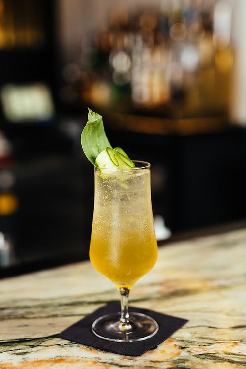 A cocktail containing Grey Goose vodka stirred with lime, elderflower, lemonade, and freshly-snipped basil (name not disclosed) at Bakshish Bar at Mahane Yehuda Market, often called 'The Shuk'  in Jerusalem, Israel, on November 21, 2017.