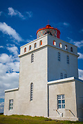 The Dyrhólaey lighthouse is located on the central south coast of Iceland. The Dyrhólaey lighthouse consists of a square concrete tower, painted white with red trim. Integral keepers quarters are placed on the left and right sides of the tower. A red metal lantern house is placed on top of the tower. The focal plane of the light is 118 m (387 ft). The overall height of the tower is 13 m (43 ft). The site (but not the tower) is open to visitors.