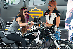 Laurie Schlenvogt of Harley-Davidson coaches Katie Still of South Dakota in the Jumpstart area of the Harley-Davidson downtown display during the annual Sturgis Black Hills Motorcycle Rally. Sturgis, SD, USA. August 6, 2014.  Photography ©2014 Michael Lichter.