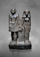 Ancient Egyptian bust of a man and women, serpentine, Middle Kingdom, late 12th-13th Dynasty (1800-1700 BC). Egyptian Museum, Turin. Grey background<br /> <br /> An example of Egyptian private statues, probably low ranking officials, inv 1222 &1233 .<br /> <br /> If you prefer to buy from our ALAMY PHOTO LIBRARY  Collection visit : https://www.alamy.com/portfolio/paul-williams-funkystock/ancient-egyptian-art-artefacts.html  . Type -   Turin   - into the LOWER SEARCH WITHIN GALLERY box. Refine search by adding background colour, subject etc<br /> <br /> Visit our ANCIENT WORLD PHOTO COLLECTIONS for more photos to download or buy as wall art prints https://funkystock.photoshelter.com/gallery-collection/Ancient-World-Art-Antiquities-Historic-Sites-Pictures-Images-of/C00006u26yqSkDOM