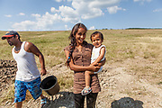Jana, 23 year old wife of Emil (20) and mother of a son and a daughter. On the left side Michal during the construction of the well. The young families corporate with the foundation ETP Slovakia which has a project in Rankovce setting up micro-loan funds for the local Roma community. Loans from this fund enabled families to build their own low-cost brick homes, on land they own.