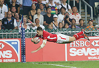 HONG KONG, HONG KONG : Cory Allen of Wales scores against Fiji, in Fiji's 26-19 win in the Cup Final, to defend their Hong Kong Rugby Sevens title, shown in Hong Kong on Sunday, 24 March, 2013.
