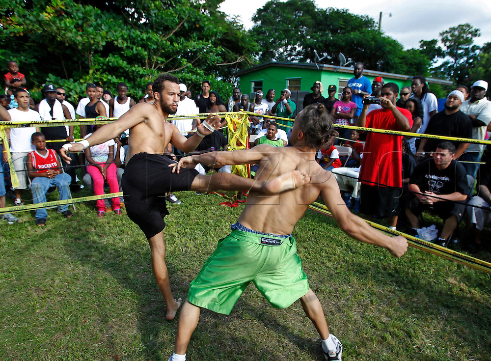 """In the ring fighters spar on September 18, 2010. Dhafir Harris, """"Dada 5000"""", puts on backyard fights at his mother house, which go viral on youtube and have been the subject of documentaries. Sometimes the men fight until they are unconscious. There' s no gloves and occasionally, there's a cage. The community has taken to the events, because they are able to set up businesses selling food and washing cars."""