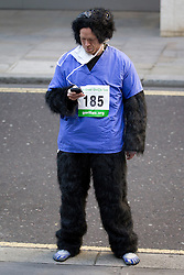 © Licensed to London News Pictures. 22/09/2012. LONDON, UK. A runner wearing medically themed gorilla costume checks his phone as he waits to begin the 2012 Great Gorilla Run in London today (22/09/12). Now in its 10th year, the annual event sees hundreds of competitors take part in a 7km fun-run dressed as gorillas to raise money for mountain gorilla conservation projects in Africa. Photo credit: Matt Cetti-Roberts/LNP