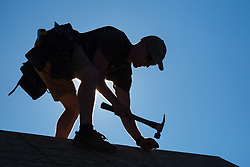 United States, Washington, Seattle, Man building house for homeless at Camp Second Chance