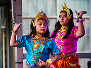 """29 APRIL 2017 - MINNEAPOLIS, MINNESOTA: Girls perform a dance from the Ramakien (Thai version of the Indian epic, the Ramayana) during Songkran Uptown. Several thousand people attended Songkran Uptown on Hennepin Ave in Minneapolis for the city's first celebration of Songkran, the traditional Thai New Year. Events included a Thai parade, a performance of the Ramakien (the Thai version of the Indian Ramayana), a """"Ladyboy"""" (drag queen) show, and Thai street food.     PHOTO BY JACK KURTZ"""