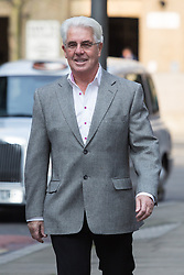@Licensed to London News Pictures. 27/03/2014. London, UK. Publicist, Max Clifford arrives at Southwark Crown Court in London on 27th March 2014. Clifford is charged with 11 counts of indecent assault after being arrested as part of the Metropolitan Police's Operation Yewtree. Photo credit: Vickie Flores/LNP.