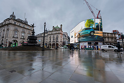 © Licensed to London News Pictures. 21/12/2020. LONDON, UK. A quiet Piccadilly Circus in the West End as Tier 4, Stay at Home, alert level restrictions are imposed on much of the UK to combat the ongoing coronavirus pandemic in the light of a recently discovered mutant strain that was discovered in the south east of England.  Photo credit: Stephen Chung/LNP