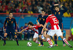 Nelson Valdez of Paraguay vs Sergio Busquets of Spain and Gerard Pique of Spain during the  2010 FIFA World Cup South Africa Quarter Finals football match between Paraguay and Spain on July 03, 2010 at Ellis Park Stadium in Johannesburg. (Photo by Vid Ponikvar / Sportida)