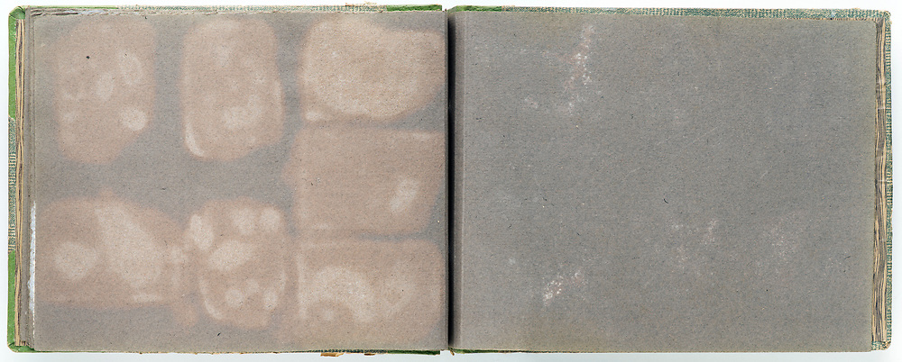 empty deteriorating page from a family photo album France ca 1950s