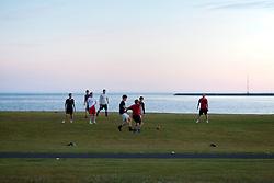Soccer players at midnight in Seltjarnarnes, Iceland-  Knattspyrnumenn um miðnætti á Seltjarnarnesi