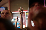 "Supporters of Pres. Barack Obama hold four fingers inthe air as they chant ""four more years"" as they watch his speech during the 2012 Democratic National Convention on Thursday, September 6, 2012 in Charlotte, NC."