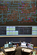 The National Grid electricity control room maps and monitors the flow of high voltage electric power around the entire UK network from their head quarters in Berkshire, United Kingdom.