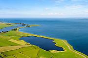 Nederland, Noord-Holland, Amsterdam, 13-06-2017; Barnegat en Uitdammerdijk, landelijk Noord. Zicht op IJsselmeer, Flevoland aan de horizon.<br /> De dijk staat op de nominatie om verstrekt te worden, bewoners en actievoerders vrezen aantasting van de monumentale dijk en verlies culturele waarden.<br /> Barnegat en Uitdammerdijk, rural area, North of Amsterdam.<br /> The dike is nominated to be reinforced, residents and activists fear losing the monumental quality of the dike and losing other cultural values.<br /> luchtfoto (toeslag op standaard tarieven);<br /> aerial photo (additional fee required);<br /> copyright foto/photo Siebe Swart